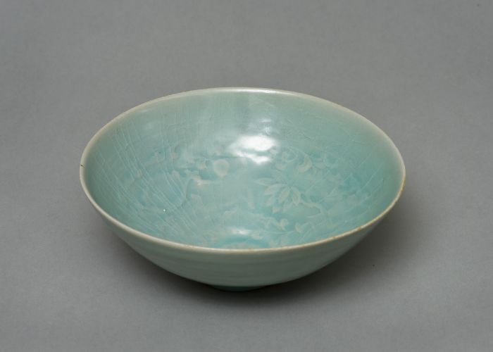 celadon bowl with lotus and children design